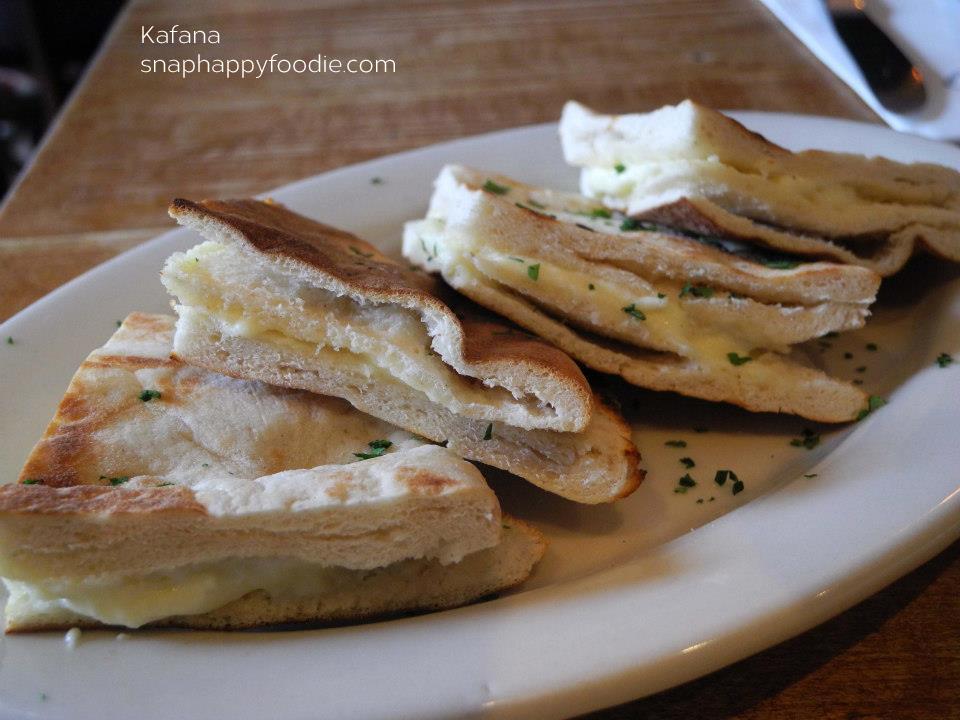Lepinja sa Kajmakom - traditional bread served warm with creamy spread (I think!)